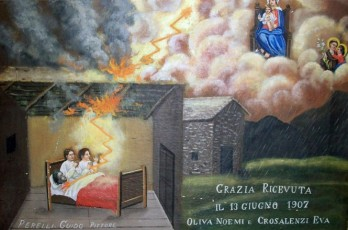 une 13, 1927. While a storm raged over Ornavasso, lightning struck the roof of a cabin and hit the bed where three women were sleeping. Scared, they prayed for a miracle. Noemi Oliva and Eva Crosa-Lenzi are saved by the Madonna and Saint Francis. From the site http://www.italianways.com/small-miracles-of-beauty-ex-votos-for-madonna-del-boden/